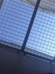 Sky through bars